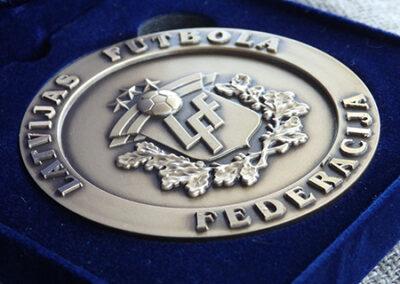 Medaljons samta kārbiņā